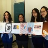 Students from Laura Holland's Junior Year Writing class display their accordion book, which holds all of their essays.