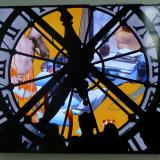 A video still of a clock with light shining through it and silhoetted figures standing in front. The time is 11:35.