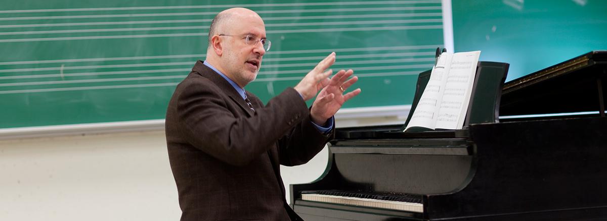 Gary S. Karpinski teaches from the piano