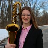 Zoe Stinson with her baritone saxophone